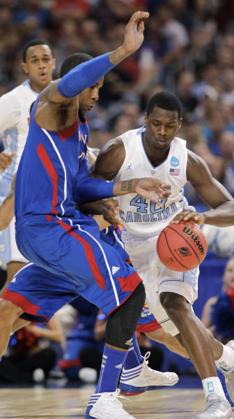 North Carolina forward Harrison Barnes (40) drives against Kansas forward Thomas Robinson during the first half of the NCAA men's college basketball tournament Midwest Regional final Sunday, March 25, 2012, in St. Louis. (AP Photo/Jeff Roberson)
