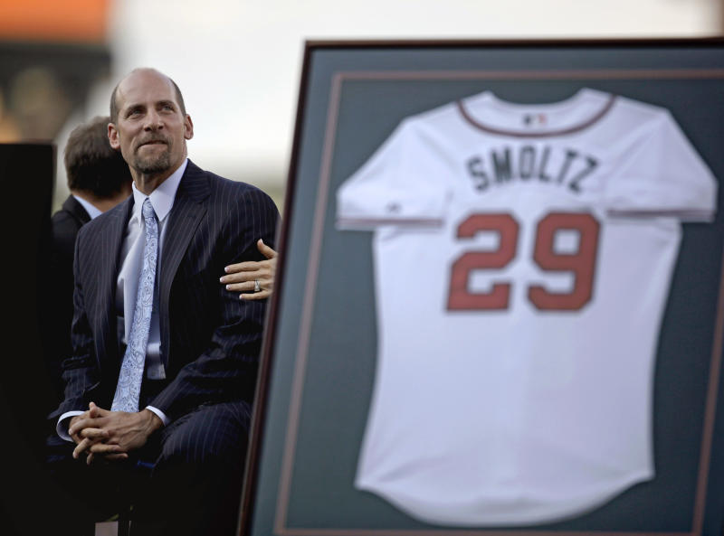 Former Atlanta Braves pitcher John Smoltz looks on as his jersey is retired during a ceremony before a baseball game between the Braves and the Toronto Blue Jays, Friday, June 8, 2012, in Atlanta. Smoltz took his place in Braves history on Friday night when the team retired his No. 29. He was inducted into the Braves Hall of Fame earlier in the day. (AP Photo/David Goldman)
