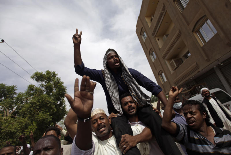 Sudanese anti-government protesters chant slogans after the Friday noon prayer in the Omdurman district of northern Khartoum, Sudan, Friday, Sept. 27, 2013. Security forces opened fire on Sudanese protesters Friday, witnesses said, as thousands marched through the streets of the capital in an opposition push to turn a wave of popular anger over fuel price hikes into an outright uprising against the 24-year rule of President Omar al-Bashir. (AP Photo/Khalil Hamra)