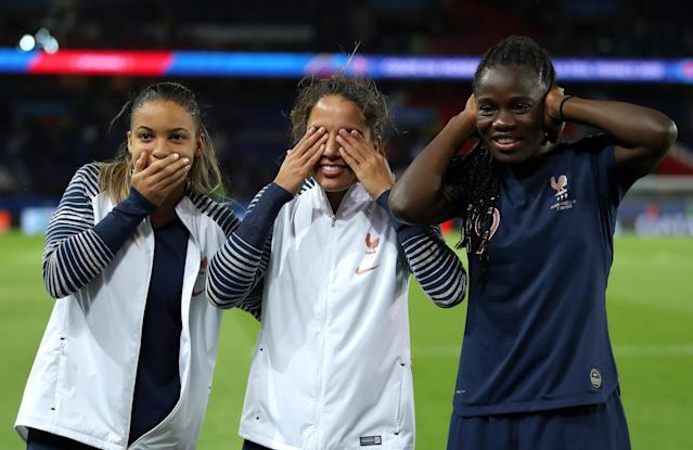 (L-R) Delphine Cascarino, Amel Majri and Griedge Mbock Bathy of France celebrate victory together after the 2019 FIFA Women's World Cup France group A match between France and Korea Republic at Parc des Princes on June 07, 2019 in Paris, France. (Photo by Alex Grimm/Bongarts/Getty Images)