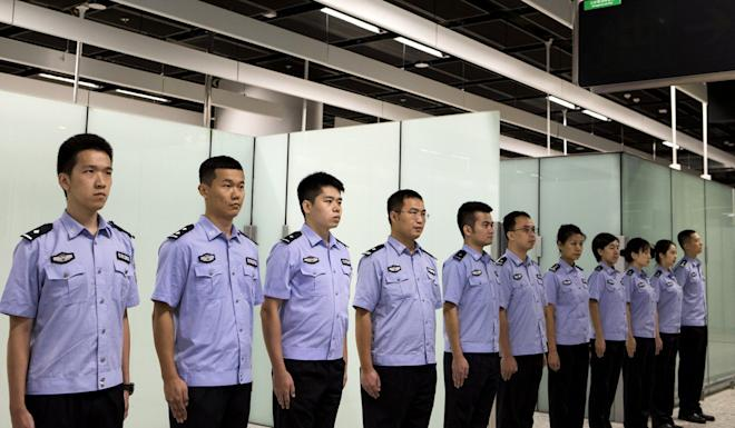Immigration officers stand in formation in the Mainland Port Area at West Kowloon Station in 2018. Photo: Reuters