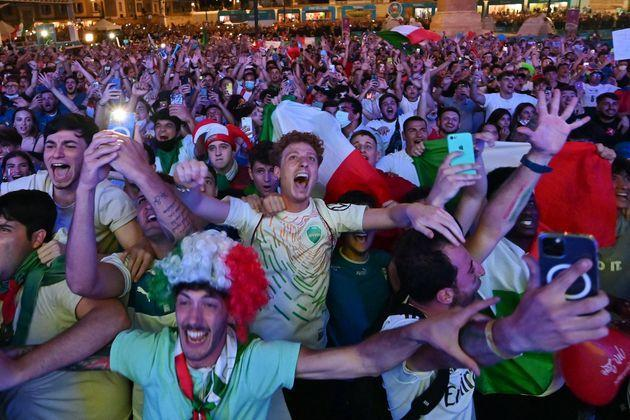 Italy's fans celebrate at the end of the broadcast of the UEFA EURO 2020 quarter-final football match between Belgium and Italy from the official fan zone at Piazza del Popolo in Rome, on July 2, 2021. (Photo by ANDREAS SOLARO / AFP) (Photo by ANDREAS SOLARO/AFP via Getty Images) (Photo: ANDREAS SOLARO via Getty Images)