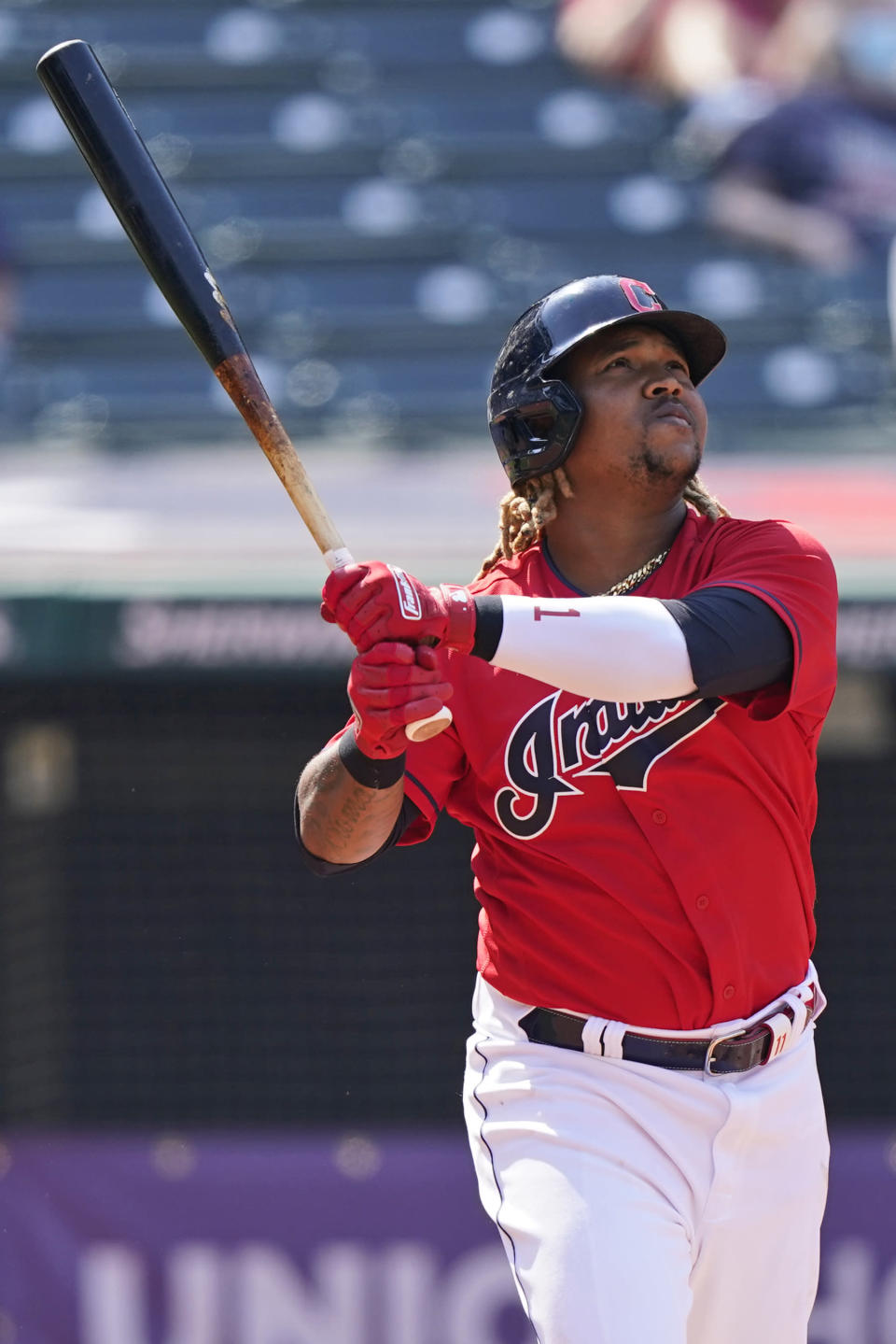 Cleveland Indians' Jose Ramirez watches his ball after hitting a two-run home run in the sixth inning of a baseball game against the Kansas City Royals, Wednesday, April 7, 2021, in Cleveland. (AP Photo/Tony Dejak)