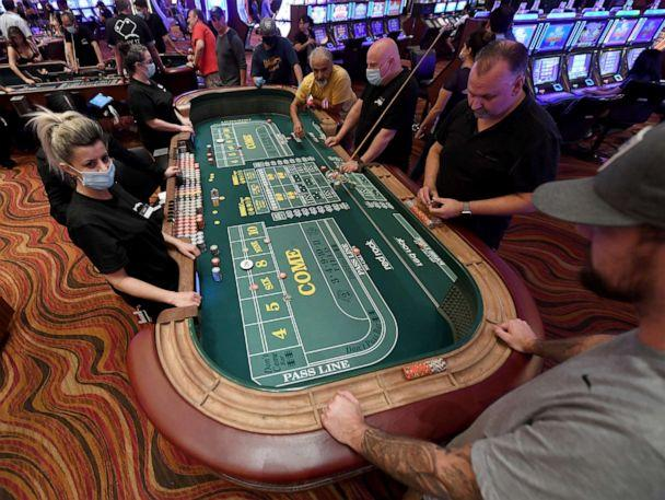 PHOTO: Guests play craps at the Red Rock Resort after the property opened for the first time since being closed on March 17 because of the coronavirus (COVID-19) pandemic on June 4, 2020 in Las Vegas. (Ethan Miller/Getty Images, FILE)