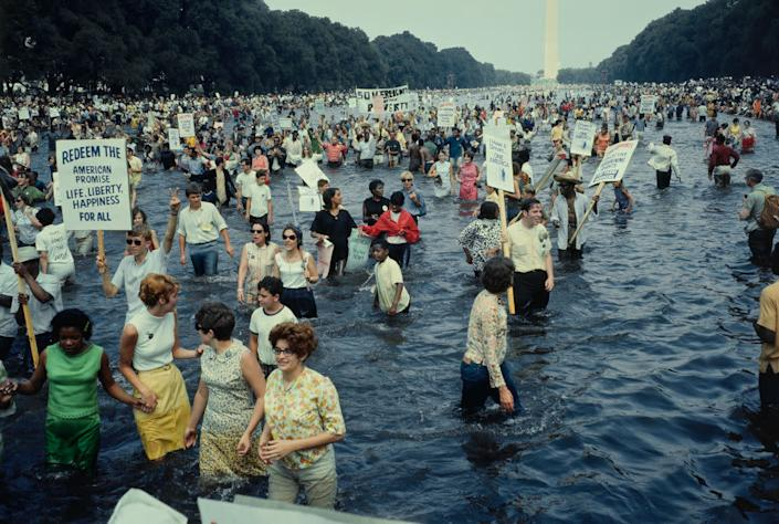 Protestors wading in the Lincoln Memorial reflecting pool in Washington, D.C., during the Poor People's Campaign, or aka the Poor People's March on Washington on June, 19, 1968. | John D. Bunns Jr./Pictorial Parade/Archive Photos—Getty Images