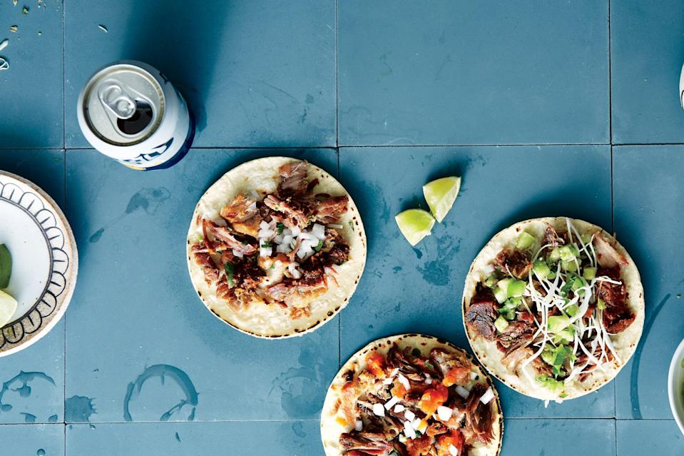 """It's worth seeking out pork belly for the amazing texture it lends, but if you can't get it, substitute with another pound of shoulder. <a href=""""https://www.epicurious.com/recipes/food/views/pork-carnitas-tacos?mbid=synd_yahoo_rss"""" rel=""""nofollow noopener"""" target=""""_blank"""" data-ylk=""""slk:See recipe."""" class=""""link rapid-noclick-resp"""">See recipe.</a>"""