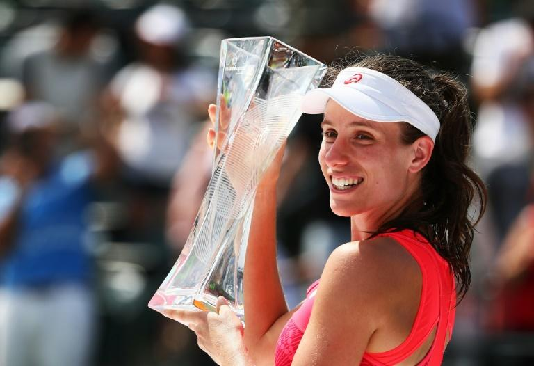 Johanna Konta of Great Britain holds the winner's trophy after defeating Caroline Wozniacki of Denmark after the Women's Final on Day 13 of the Miami Open at Crandon Park Tennis Center on April 1, 2017 in Key Biscayne, Florida