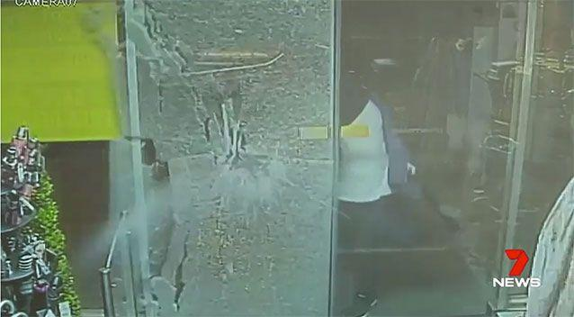 Two men smashed their way into the store with a hammer. Source: 7 News