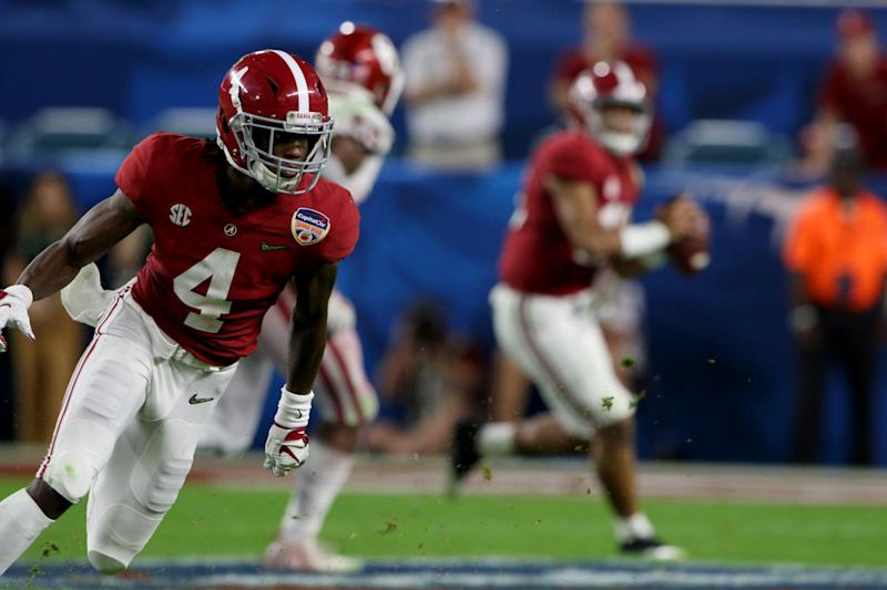 MIAMI GARDENS, FL - DECEMBER 29: Alabama Crimson Tide wide receiver Jerry Jeudy (4) runs a route as quarterback Tua Tagovailoa (13) makes the throw against the Oklahoma Sooners during the third quarter of the CFP Semifinal at the Orange Bowl on December 29, 2018 at Hard Rock Stadium in Miami Gardens, Florida. Alabama defeated Oklahoma 45-34. (Photo by Douglas Jones/Icon Sportswire via Getty Images)