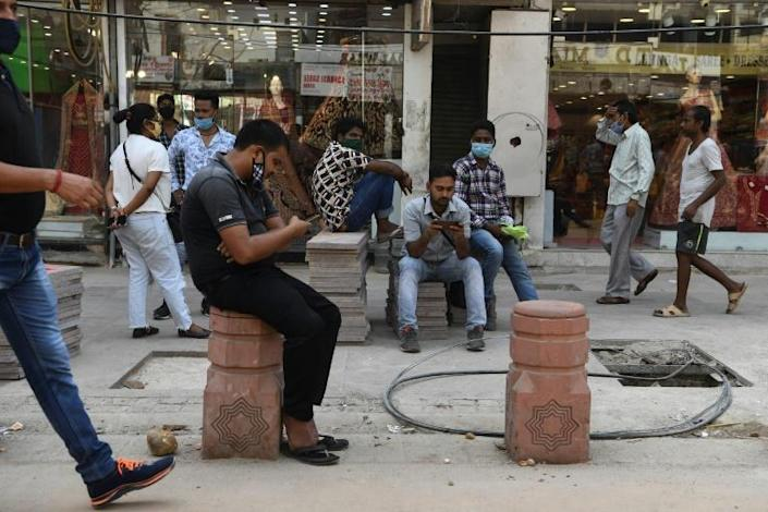 Pedestrians, some without facemasks, in a market area of New Delhi. India's coronavirus cases surged past seven million on October 11, taking it ever closer to overtaking the United States as the world's most infected country