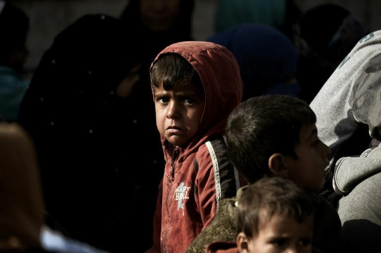 A displaced Iraqi boy cries as he flees the city of Mosul while government forces battle Islamic State group jihadists on February 28, 2017