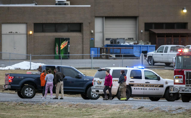 <p>Marshall County High School students are escorted to retrieve their vehicles by emergency responders after a deadly shooting at the school in Benton, Ky., Jan. 23, 2018. (Photo: Ryan Hermens/The Paducah Sun via AP) </p>