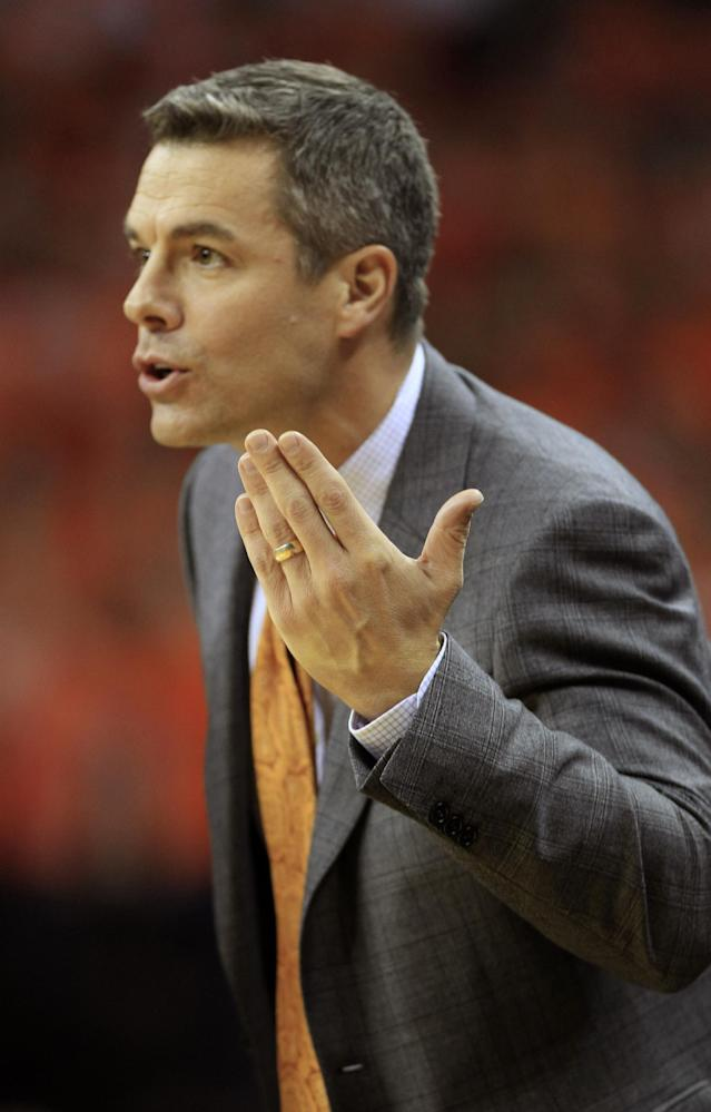 Virginia head coach Tony Bennett directs his team during the first half of an NCAA college basketball game in against Virginia Commonwealth in Charlottesville, Va., Tuesday, Nov. 12, 2013. (AP Photo/Steve Helber)