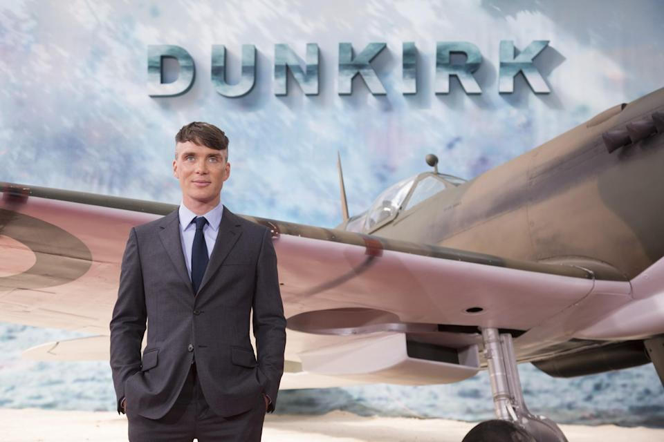 <p>Cillian Murphy posing in front of the Spitfire (WB) </p>