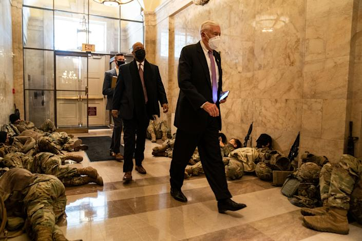 WASHINGTON, DC - JANUARY 13: U.S. House Majority Leader Steny Hoyer (D-MD) walks past members of the National Guard sleeping in the halls of Capitol Hill as the House of Representativs convene to impeach President Donald Trump, nearly a week after a pro-Trump insurrectionist mob breached the security of the nations capitol while Congress voted to certify the 2020 Election Results on Wednesday, Jan. 13, 2021 in Washington, DC. (Kent Nishimura / Los Angeles Times via Getty Images)