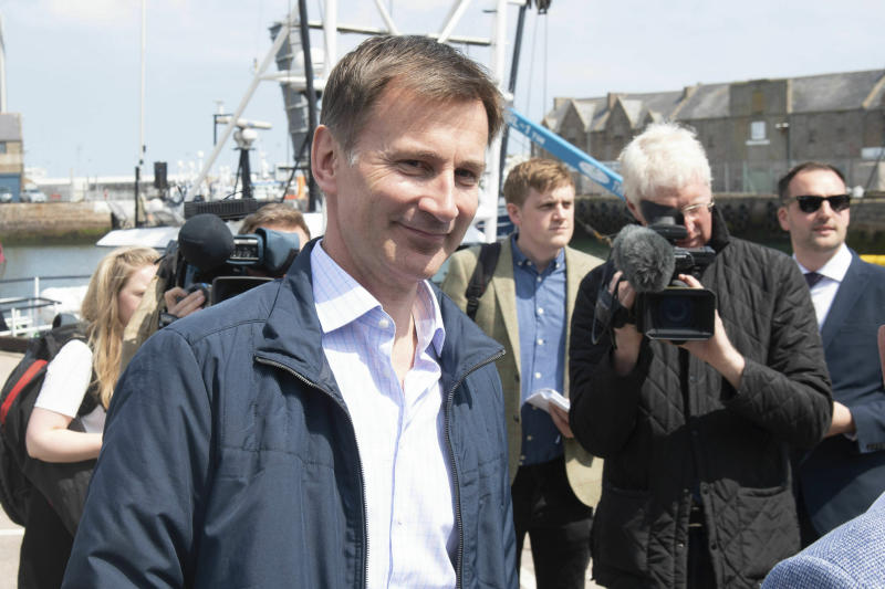Conservative Party leadership candidate Jeremy Hunt meets with local fishermen in Peterhead in Aberdeenshire, Scotland, Sunday June 23, 2019. (Michal Wachucik/PA via AP)