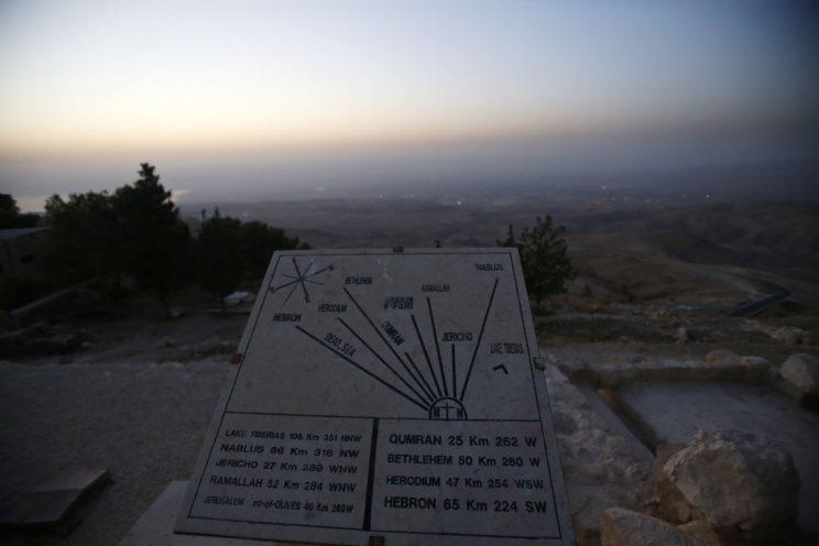 A map shows the directions and distances to Jerusalem, Jericho, Nablus, Ramallah, Lake Tiberias, Qumran, Herodium and Hebron is seen at Mount Nebo (Jordan Pix/ Getty Images)