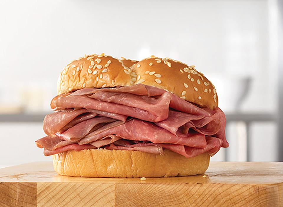 arby's classic roast beef sandwich on wood block
