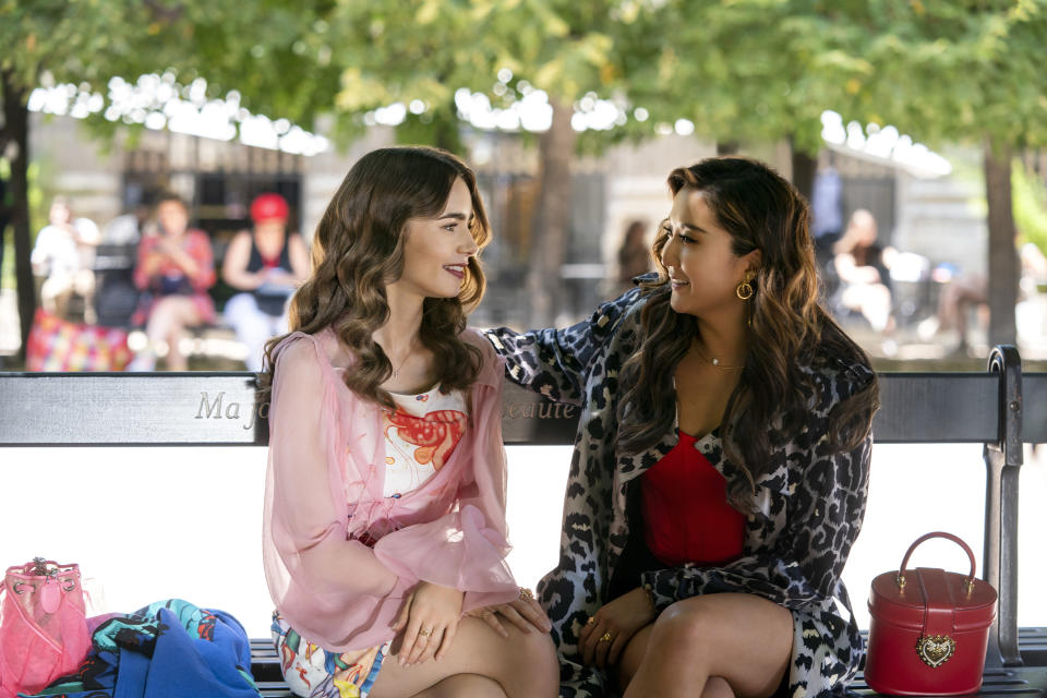 Emily in Paris. (L to R) Lily Collins as Emily, Ashley Park as Mindy in episode 210 of Emily in Paris. Cr. Stéphanie Branchu/Netflix © 2021