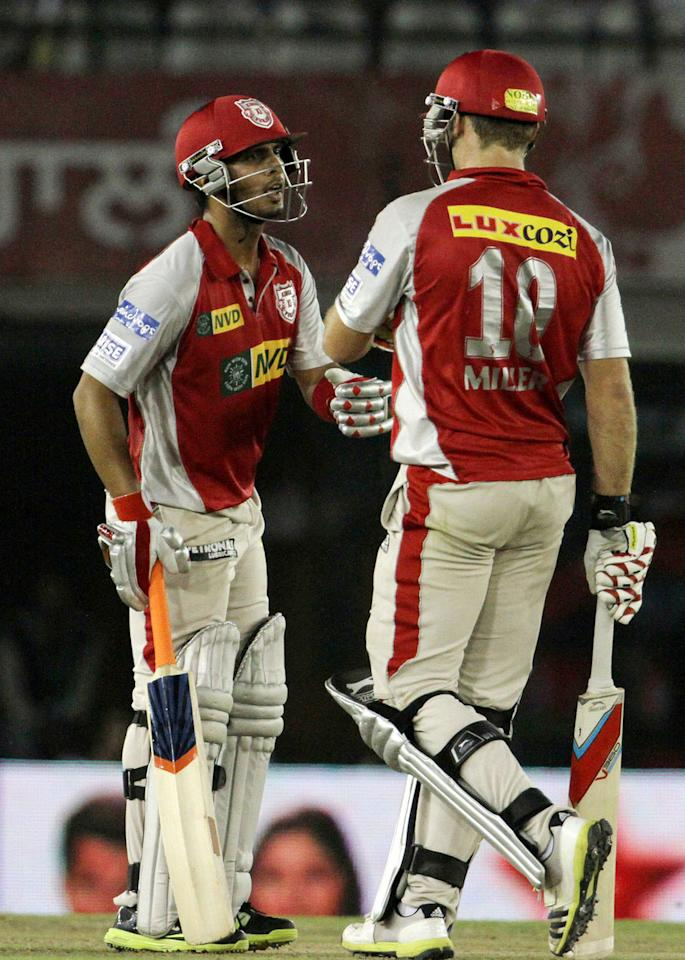 Kings XI Punjab player Mandeep Singh and Kings XI Punjab player David Miller during match 29 of the Pepsi Indian Premier League between The Kings XI Punjab and the Pune Warriors held at the PCA Stadium, Mohali, India  on the 21st April 2013. (BCCI)