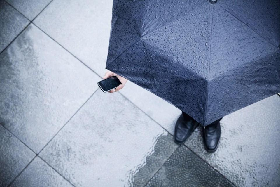 """You probably know well enough not to submerge your phone to clean it off, but many people don't realize how much using your phone in the rain can damage it. Since many people don't think that using their phone during a drizzle is akin to dunking it in a sink, they go about using it normally afterward. Big mistake. In fact, the moisture that got inside your phone when you placed that call sans umbrella could be enough to kill it completely. As DE iPhone Repair expert Gary Tan revealed to <a href=""""https://phys.org/news/2017-09-smartphone.html"""" rel=""""nofollow noopener"""" target=""""_blank"""" data-ylk=""""slk:Phys.org"""" class=""""link rapid-noclick-resp""""><em>Phys.org</em></a>, even a small amount of water in a phone, when connected to a power source, can kill a phone's circuit board, rendering it useless."""
