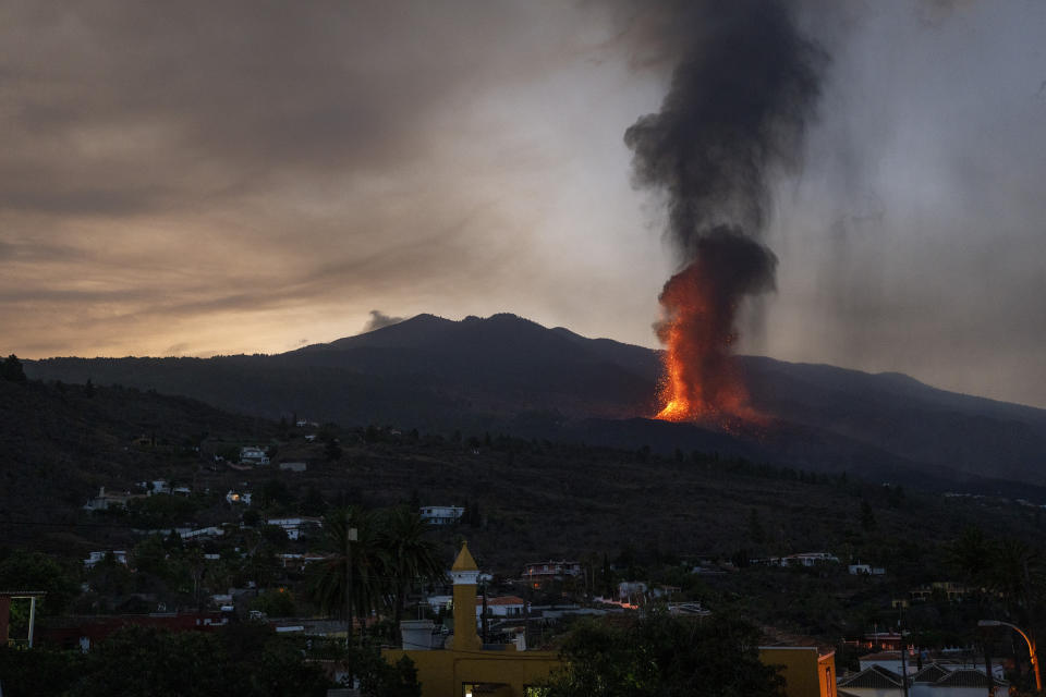 Lava flows in an eruption on the island of La Palma in the Canaries, Spain, Thursday, Sept. 23, 2021. A volcano on the small Spanish island in the Atlantic Ocean erupted on Sunday, forcing the evacuation of thousands of people. Experts say the eruption and its aftermath could last for up to 84 days. (AP Photo/Emilio Morenatti)