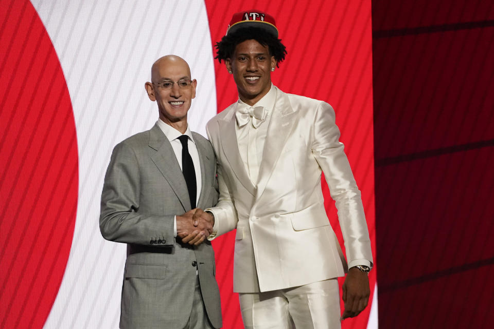 Jalen Johnson, right, poses for a photo with NBA Commissioner Adam Silver after being selected 20th overall by the Atlanta Hawks during the NBA basketball draft, Thursday, July 29, 2021, in New York. (AP Photo/Corey Sipkin)