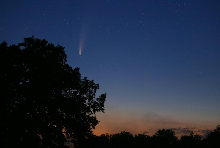 Neowise is seen before sunrise over the Allg'u landscape, in Bad W'rishofen, Bavaria, Sunday, July 12, 2020.