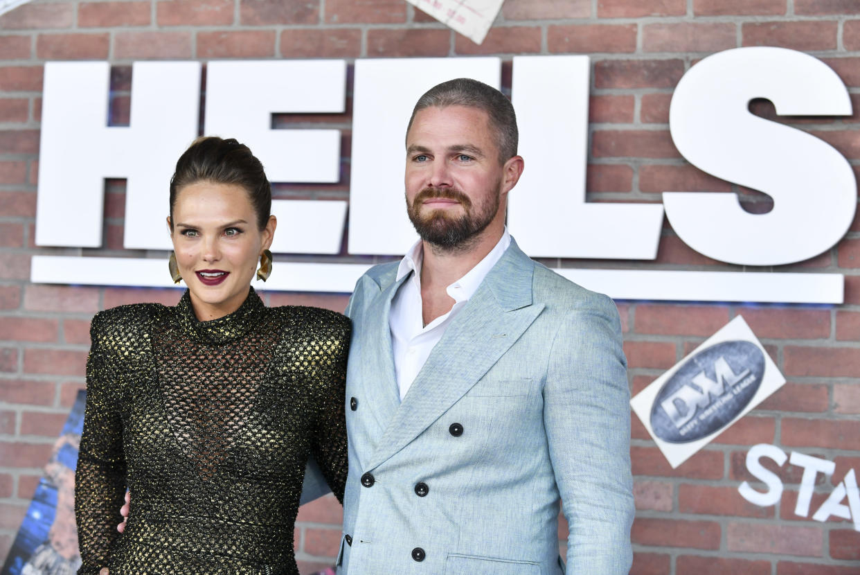 Stephen Amell, here with Cassandra Jean on Aug. 10, reveals where he and his wife stand today after he got kicked off a flight