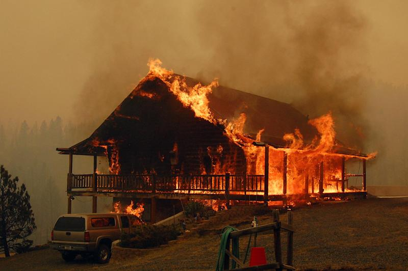 In this photo provided by the Madison County Disaster & Emergency Services, a cabin explodes in flames at the 19 mile fire, Thursday, Aug. 30, 2012 between Madison County and Butte, Mont. Rapidly expanding wildfires across a broad swath of southern Montana have caused injuries and burned homes, buildings and vehicles, authorities said Thursday, as firefighters struggled to contain the flames amid hazardous conditions. (AP Photo/Madison County Disaster & Emergency Services, Steve DiGiovanna)