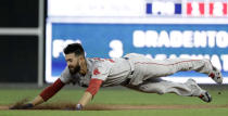 Boston Red Sox starting pitcher Rick Porcello dives into second base after hitting a double off Philadelphia Phillies starting pitcher Nick Pivetta during the third inning of a baseball game, Tuesday, Aug. 14, 2018, in Philadelphia. (AP Photo/Matt Slocum)