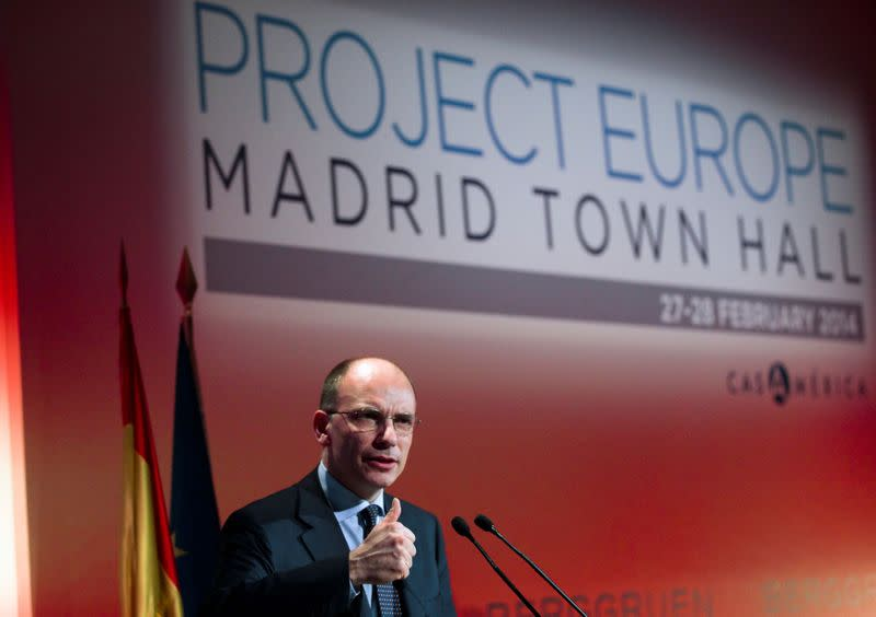 """FILE PHOTO: Former Italy's Prime Minister Enrico Letta gestures as he delivers a keynote speech during the """"Project Europe"""" event in Madrid"""