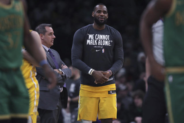 Los Angeles Lakers forward LeBron James talks with head coach Frank Vogel during the fourth quarter of an NBA basketball game against the Boston Celtics in Boston, Monday, Jan. 20, 2020. The Celtics defeated the Lakers 139-107. (AP Photo/Charles Krupa)