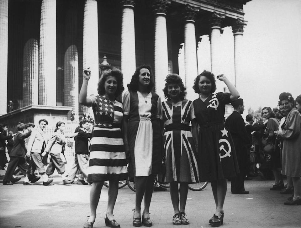<p>A group of women dress in outfits representing the allied countries—the United States, France, Great Britain, and the Soviet Union—for a V-E Day celebration. </p>
