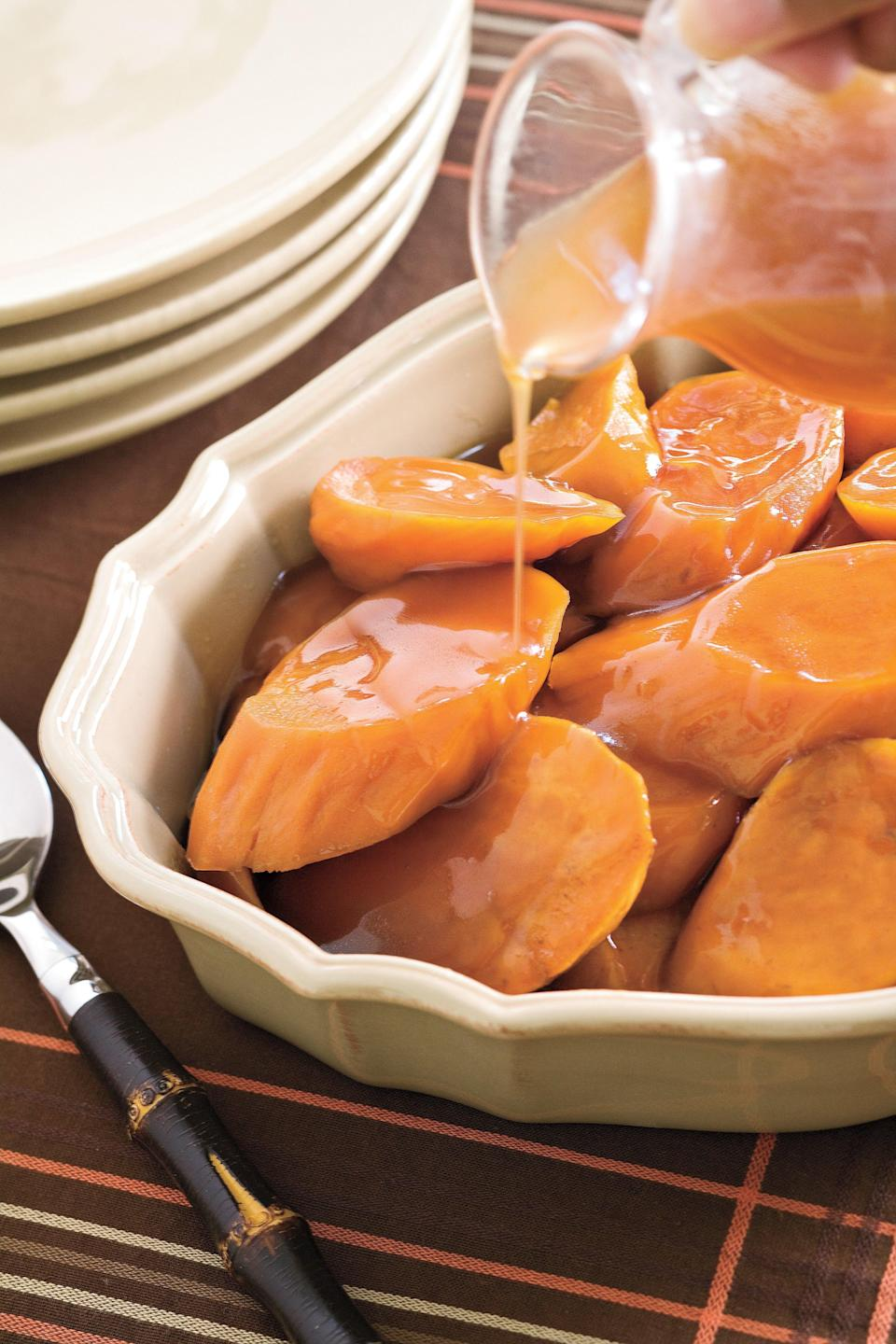 """<p><strong>Recipe:</strong> <strong><a href=""""http://www.myrecipes.com/recipe/candied-yams-10000001842446/"""" rel=""""nofollow noopener"""" target=""""_blank"""" data-ylk=""""slk:Candied Yams"""" class=""""link rapid-noclick-resp"""">Candied Yams</a></strong></p> <p>We updated the Southern staple candied yams recipe so that it can be cooked in a slow cooker. It's an extra-easy choice to heat and take to your next family gathering or potluck dinner.</p> <p><strong>Step-by-Step Video: <a href=""""http://www.myrecipes.com/how-to/video/how-to-make-candied-yams-00420000025815/"""" rel=""""nofollow noopener"""" target=""""_blank"""" data-ylk=""""slk:Slow-Cooker Candied Yams"""" class=""""link rapid-noclick-resp"""">Slow-Cooker Candied Yams</a></strong></p>"""