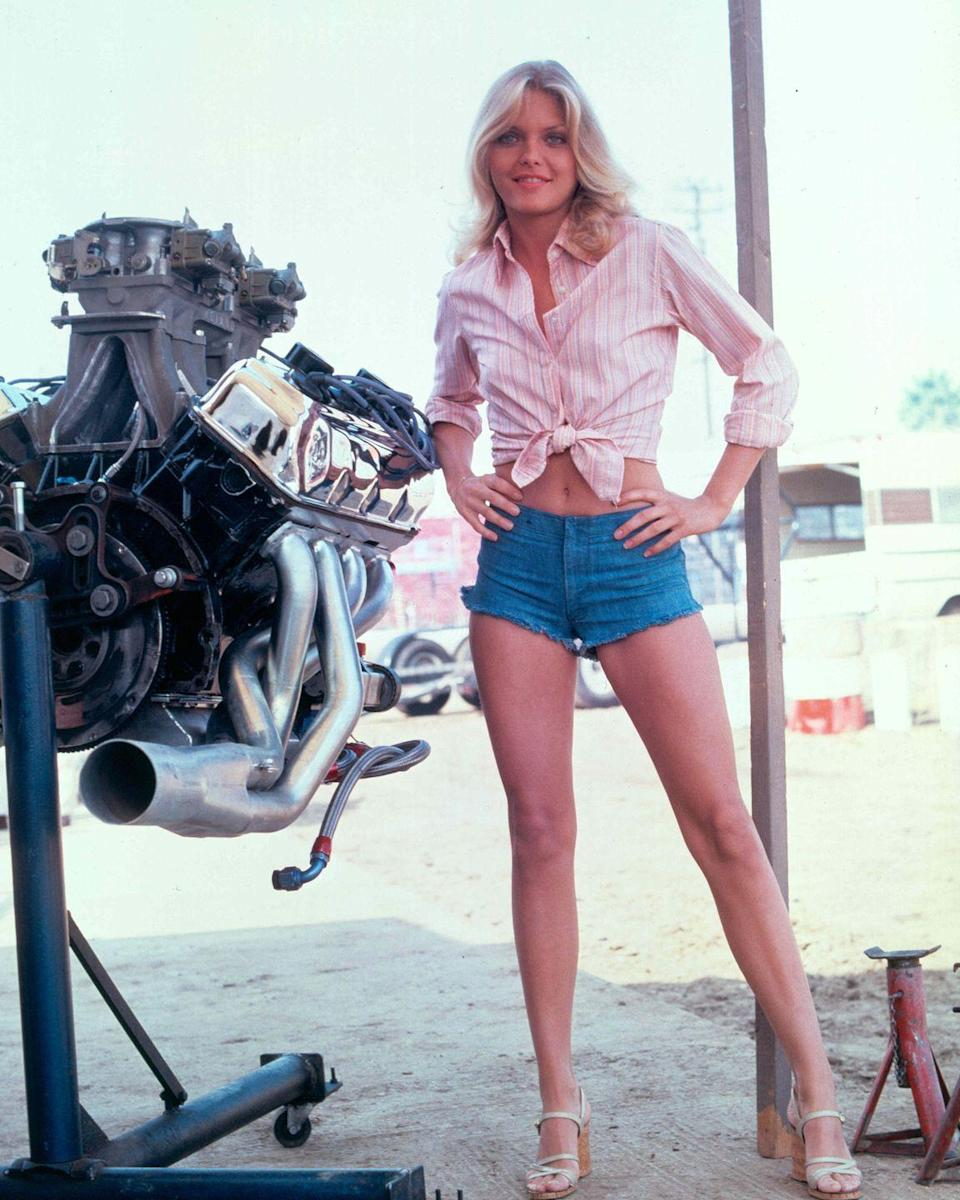 <p>Michelle Pfeiffer sports a pair of jean shorts that seem a far, far cry from the knee-length denim shorts Goldie Hawn wore fifteen years before.</p>