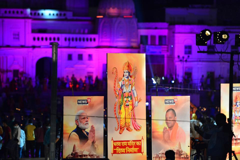 Banners with the images of (L-R) Indian Prime Minister Narendra Modi, Lord Ram and Chief Minister of Uttar Pradesh Yogi Adityanath are seen along the banks of the River Sarayu on the ever before the groundbreaking ceremony of the proposed Ram Temple in Ayodhya on August 4, 2020. - India's Prime Minister Narendra Modi will lay the foundation stone for a grand Hindu temple in a highly anticipated ceremony at a holy site that was bitterly contested by Muslims, officials said. The Supreme Court ruled in November 2019 that a temple could be built in Ayodhya, where Hindu zealots demolished a 460-year-old mosque in 1992. (Photo by SANJAY KANOJIA / AFP) (Photo by SANJAY KANOJIA/AFP via Getty Images)