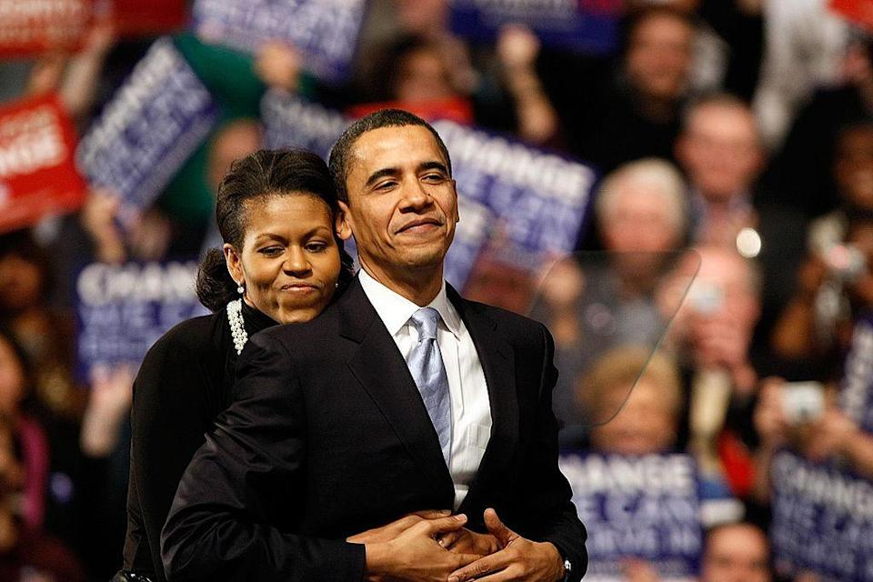 <p>Michelle hugs Barack before a speech in Nashua, New Hampshire [Photo: Win McNamee/Getty] </p>