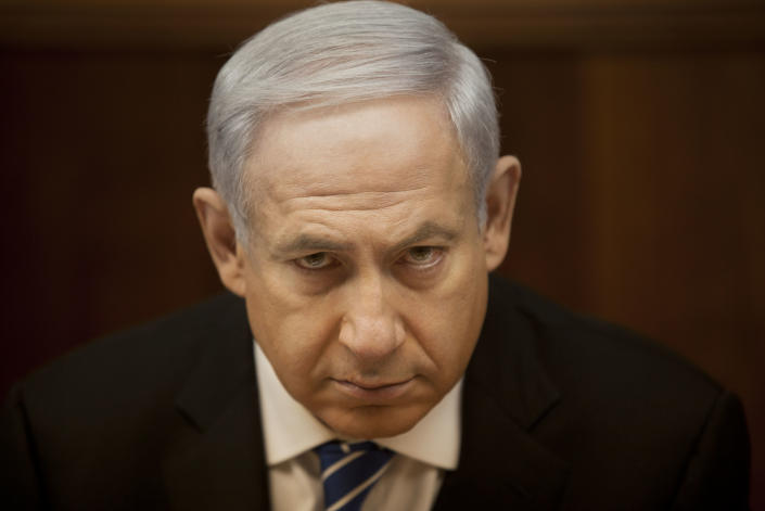 File - In this March 10, 2013 file photograph, Israeli Prime Minister Benjamin Netanyahu attends the weekly cabinet meeting in his Jerusalem office. Netanyahu signed a coalition deal Friday March 15, 2013, with rival parties to form the next government, a spokesman said, in an agreement that was stalled for weeks due to tough negotiations. (AP Photo/Sebastian Scheiner, File)
