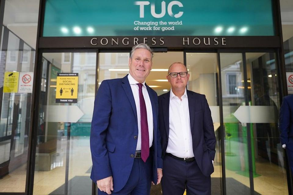 Labour leader Sir Keir Starmer arrives at the TUC congress in London greeted by TUC Deputy General Secretary Paul Nowak (Stefan Rousseau/PA) (PA Wire)