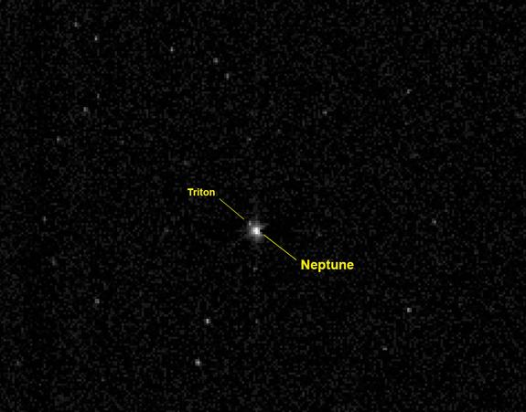 This labeled photo identifies the planet Neptune and its large moon Triton as they appeared to NASA's New Horizons spacecraft on July 10, 2014 from a distance of 2.45 billion miles (3.96 billion km). New Horizons is headed for a 2015 flyby of t