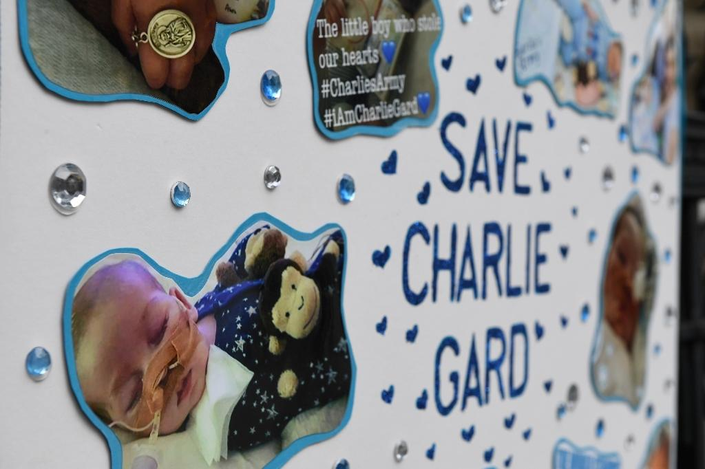 """Our beautiful little boy has gone. We are so proud of you, Charlie,"" his mother Connie Yates said in a statement (AFP Photo/Chris J Ratcliffe)"
