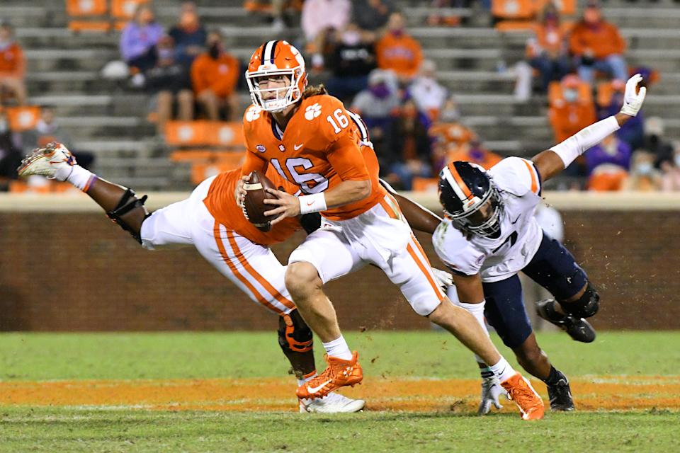 CLEMSON, SC - OCTOBER 03: Clemson Tigers quarterback Trevor Lawrence (16) scrambles up the field during the game between the Clemson Tigers and the Virginia Cavaliers on October 03, 2020 at Memorial Stadium in Clemson, South Carolina. (Photo by Dannie Walls/Icon Sportswire via Getty Images)