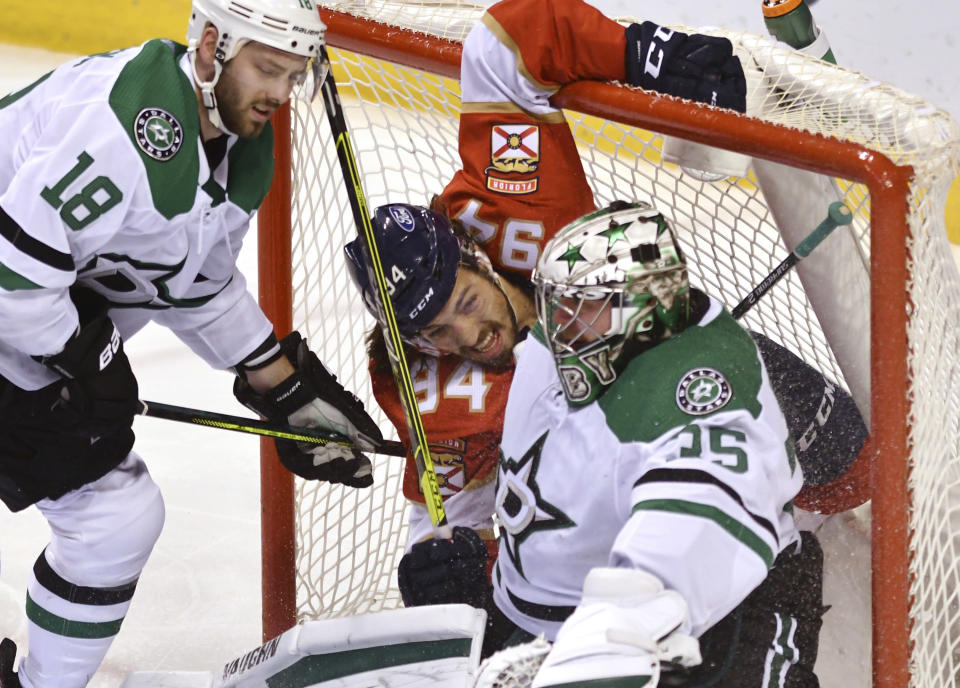 Florida Panthers left wing Ryan Lomberg (94) winds up in the net with Dallas Stars goaltender Anton Khudobin (35) as Dallas Stars center Jason Dickinson (18) looks on during the second period of an NHL hockey game Wednesday, Feb. 24, 2021, in Sunrise, Fla. (AP Photo/Jim Rassol)