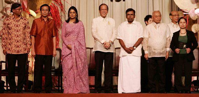 President Benigno Aquino III (center) poses for photo opportunity with 2012 Ramon Magsaysay awardees (left to right) Ambrosius Ruwindrijarto of Indonesia, Yang Saing Koma of Cambodia, Syeda Rizwana Hasan of Bangladesh, Kulandei Francis of India, Romulo Davide of Philippines, and Chen Shu-Jiu of Taiwan, during the awarding ceremony held Aug. 31 at the Philippine International Convention Center in Pasay City. (Mike Alquinto, NPPA Images)