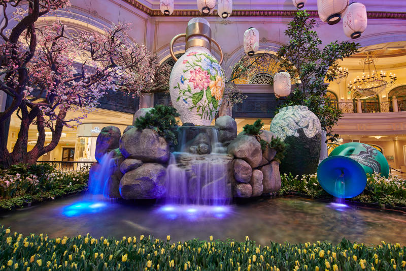 Bellagio's Conservatory & Botanical Gardens in Las Vegas celebrates Japan with vibrant spring display through June 15, featuring replica of iconic Osaka Castle and 65,000 fresh flowers