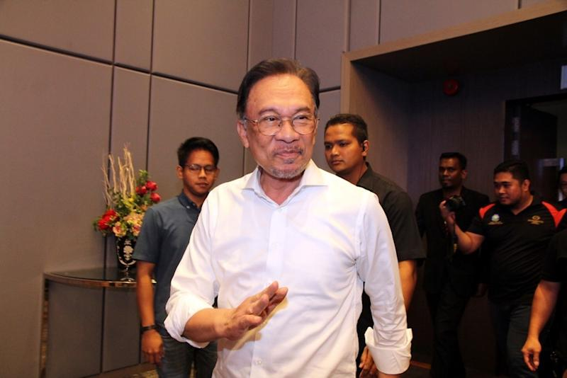 First Picture: PKR president Datuk Seri Anwar Ibrahim gestures to his party members during a townhall session entitled 'Millennials Challenge Towards New Malaysia' in the Grand Paragon Hotel in Johor Baru today. — Picture by Ben Tan