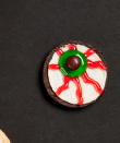 """<p>Carefully twist apart chocolate sandwich cookies to create the base for this kid-friendly recipe. It couldn't be easier.</p><p><strong><a href=""""https://thepioneerwoman.com/food-cooking/recipes/a32129658/sandwich-cookie-eyeballs-recipe/"""" rel=""""nofollow noopener"""" target=""""_blank"""" data-ylk=""""slk:Get the recipe."""" class=""""link rapid-noclick-resp"""">Get the recipe.</a></strong></p><p><a class=""""link rapid-noclick-resp"""" href=""""https://go.redirectingat.com?id=74968X1596630&url=https%3A%2F%2Fwww.walmart.com%2Fip%2FThe-Pioneer-Woman-Vintage-Floral-14-5-Inch-Serving-Platter%2F147105294&sref=https%3A%2F%2Fwww.thepioneerwoman.com%2Ffood-cooking%2Fmeals-menus%2Fg32110899%2Fbest-halloween-desserts%2F"""" rel=""""nofollow noopener"""" target=""""_blank"""" data-ylk=""""slk:SHOP SERVING PLATTERS"""">SHOP SERVING PLATTERS</a></p>"""