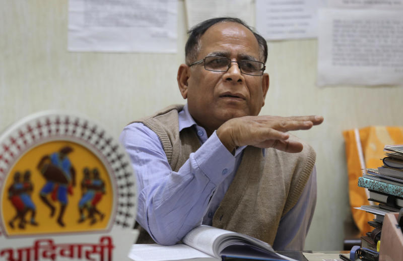 """Anthropology professor at Delhi University P.C. Joshi speaks to the Associated Press in his office in New Delhi, India, Thursday, Nov. 22, 2018. The Indian island where a young American was killed last week has been cut off from the world for thousands of years, with islanders enforcing their own isolation. While scholars believe North Sentinelese islanders probably migrated from Africa roughly 50,000 years ago, almost nothing is known about their lives today, from what language they speak to how many survive. """"We have become a very dangerous people,"""" Joshi said, """"even minor influences can kill them."""" (AP Photo/Manish Swarup)"""