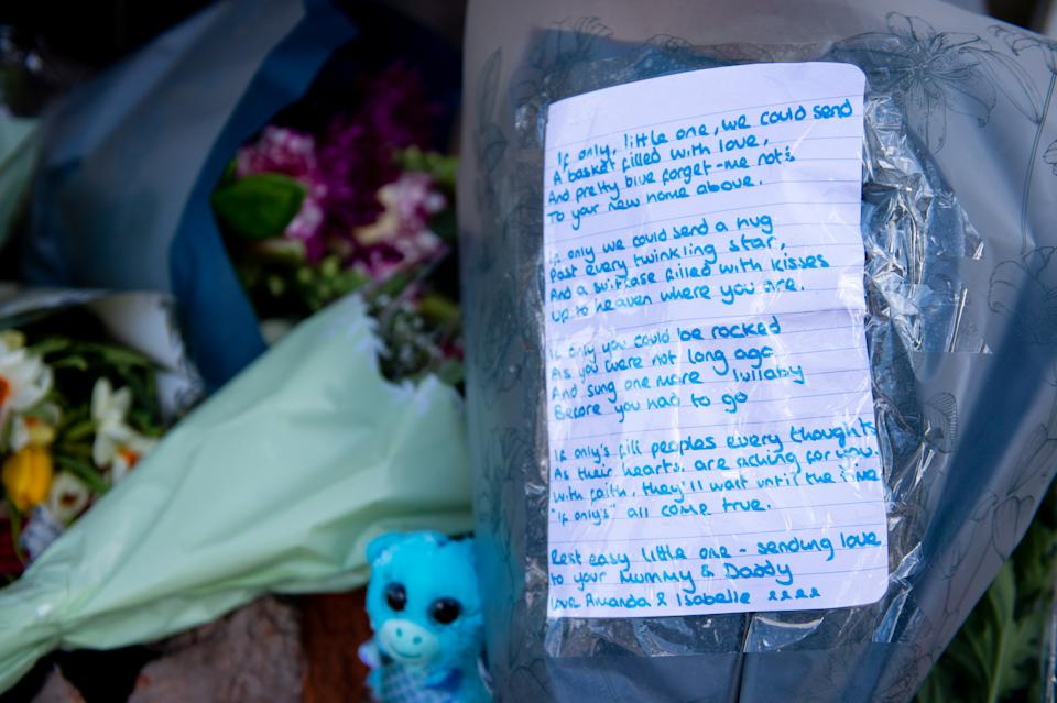 A tribute left by a mourner with a bunch of flowers for Ciaran Leigh Morris.